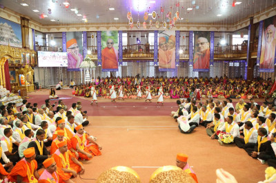 Young devotees perform a classical dance to please Lord Shree Swaminarayanbapa Swamibapa