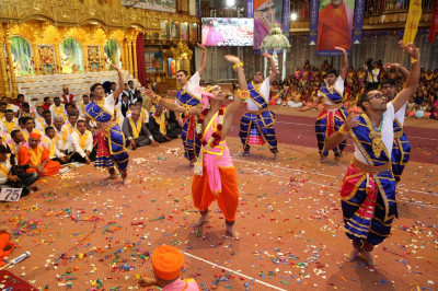 Sants and devotees perform devotional dances
