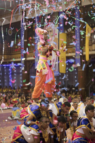 Sants and devotees perform a devotional dance
