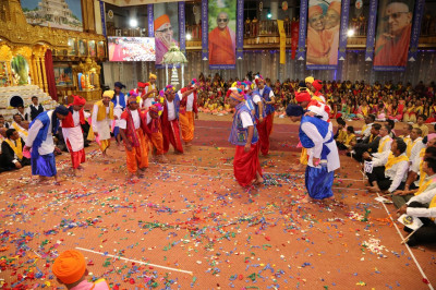 Devotees perform a dance