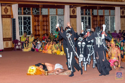 Students of Swamibapa Education Center participate as demons in the play