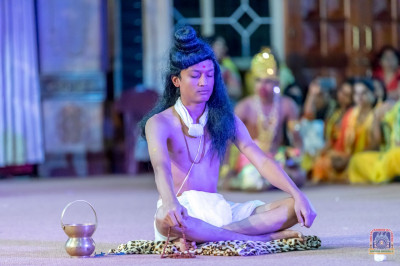 A student plays the role of Nilkanth Varni in the play