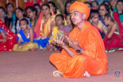 A student plays the role of Sukhanand Swami in the play