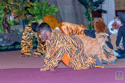 Students of Swamibapa Education Center participate as various wild animals in the play