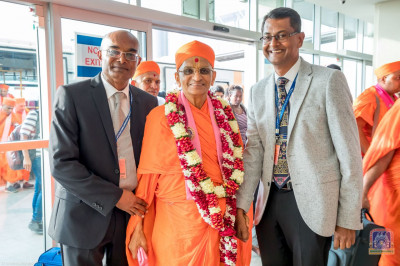 Devotees welcome H.D.H Acharya Swamishree at Entebbe International Airport