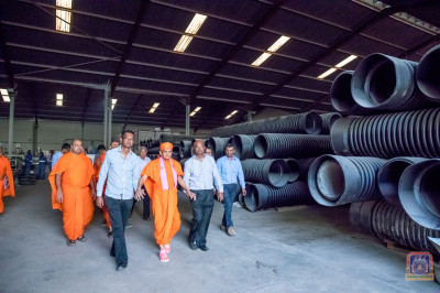 H.D.H Acharya Swamishree takes a tour in a factory