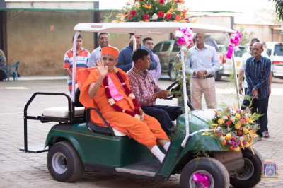 H.D.H Acharya Swamishree takes a tour in a golf cart
