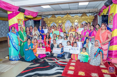 Devotees pose for a group photo on the 216th Swaminarayan Mahamantra Jayanti