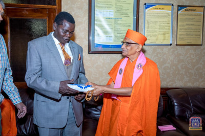 H.D.H Acharya Swamishree blesses one of the Honourable official