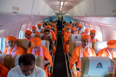 Sants and devotees board their flight back to Nairobi