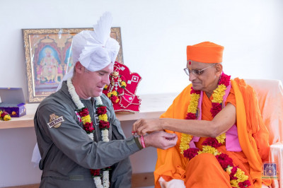 H.D.H Acharya Swamishree blesses one of the members of the Mara Elephant Project Trust
