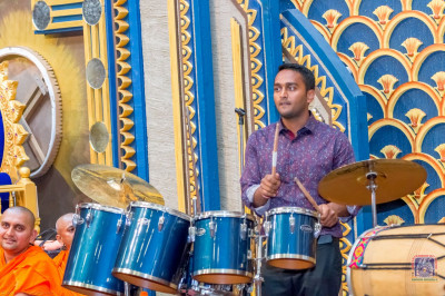 Musicians play drums and singing along devotional songs