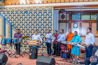 Musicians play various musical instruments and singing devotional songs