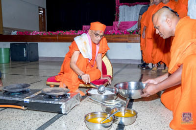 H.D.H Acharya Swamishree prepares the dough for rotlas
