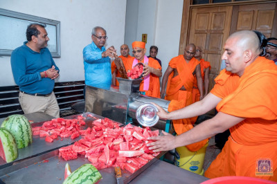 H.D.H Acharya Swamishree consecrates the watermelon juice