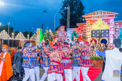 Devotees perform a welcome dance