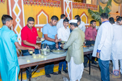 Devotees being served dinner