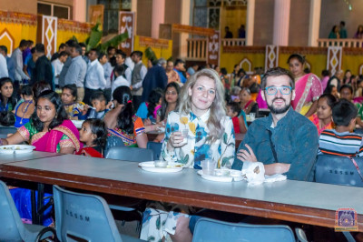 Devotees and various visitors have dinner