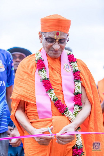 H.D.H Acharya Swamishree does the cricket pitch opening