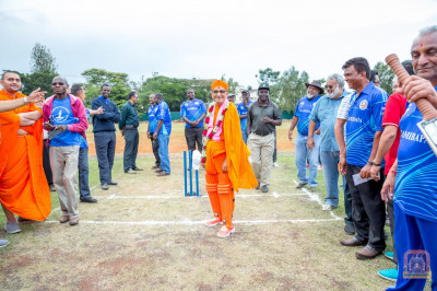 H.D.H Acharya Swamishree bowling on the new cricket pitch