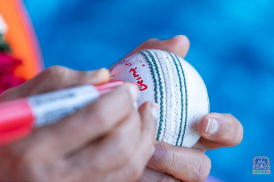 H.D.H Acharya Swamishree autographs the cricket ball