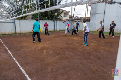 Devotees enjoy playing volleyball