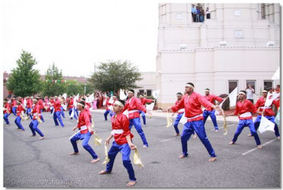 Disicples perform a welcoming dance across the grounds of Shree Swaminarayan Temple New Jersey