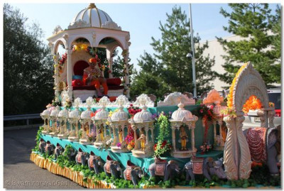 Acharya Swamishree seated on beautifully-decorated chariot