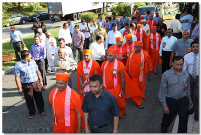 Sants and disciples lead the magnificent chariot through the grounds at Shree Swaminarayan Temple New Jersey