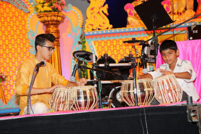 Two young disciples showcase their talents developed through online tabla classes administered from Maninagar