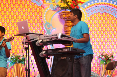 A performer from the band skillfully plays multiple keyboards to accompany Jeffrey Iqbal�s resounding voice