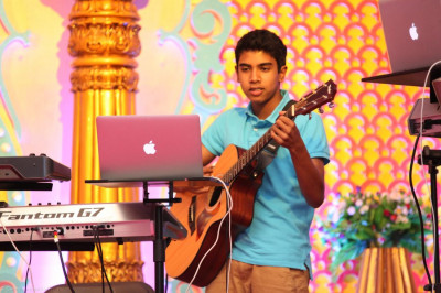 A young band performer contributes chords and accents to the musical composition