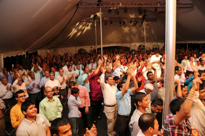 Disciples dance along with Acharya Swamishree and sants