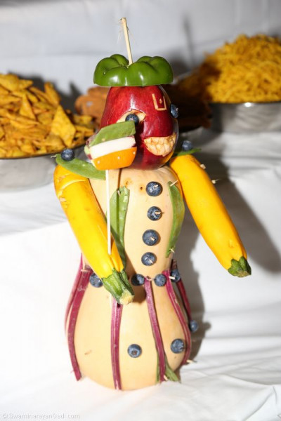 A handcrafted annkut offering composed of a variety of fruits and vegetables
