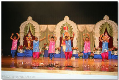 "Young devotes perform devotional dance to the kirtan ""Swamin Swamin"""