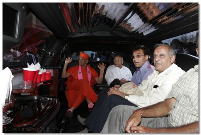 Acharya Swamishree and disciples are going to JFK airport in a limousine
