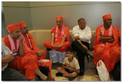 Acharya Swamishree and sants are waiting to check-in