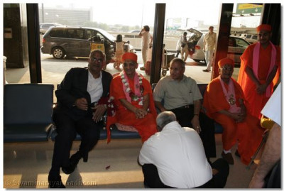Acharya Swamishree gives His divine darshan at Newark International Airport upon arrival to the United States