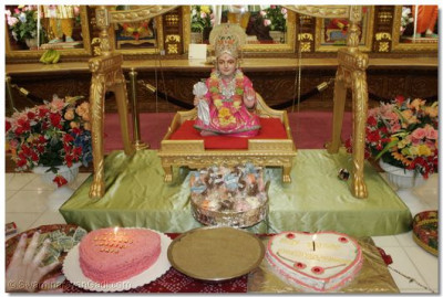 The Lord is seated on a golden swing throughout the celebration, and cakes and chocolates are offered to Him