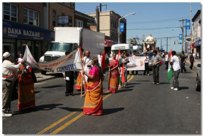 Members of the India Day Parade Committee walk in the parade