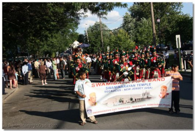 Swamibapa Pipe Band leads the parade to Buchmuller Park
