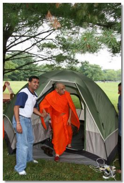 Acharya Swamishree is escorted out of the tent