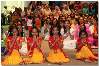 "Young disciples perform a devotional dance to the kirtan ""Aavo Aavo Ghanshyamji"""