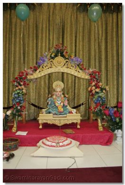 Lord Shree Swaminarayan gives His divine darshan seated on a golden swing