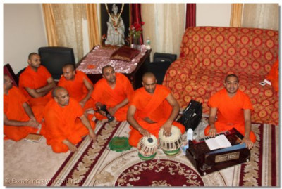 Sants perform kirtan-bhakti in the home of a disciple in Rochester, New York