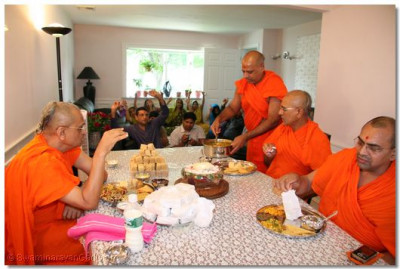 Acharya Swamishree and sants have prasad at a disciple's home in New Jersey