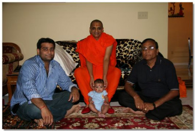 Acharya Swamishree blesses a young child