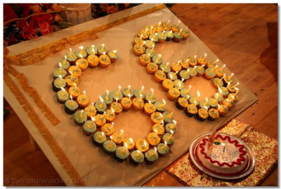 "Disciples had created a large ""66"" out of cupcakes in honor of Acharya Swamishree's 66th birthday"