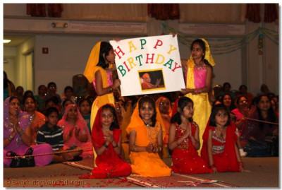 "Disciples perform a devotional dance to the kirtan ""Happy Birthday to You"""
