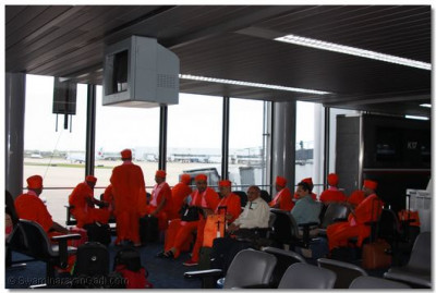Acharya Swamishree and sants in the departures lounge at Chicago Airport